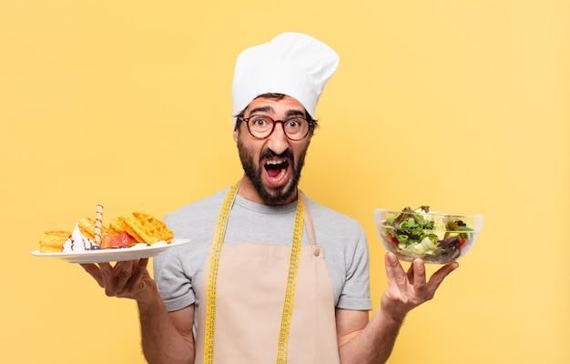 Jonge, bebaarde chef-kok man droevige uitdrukking