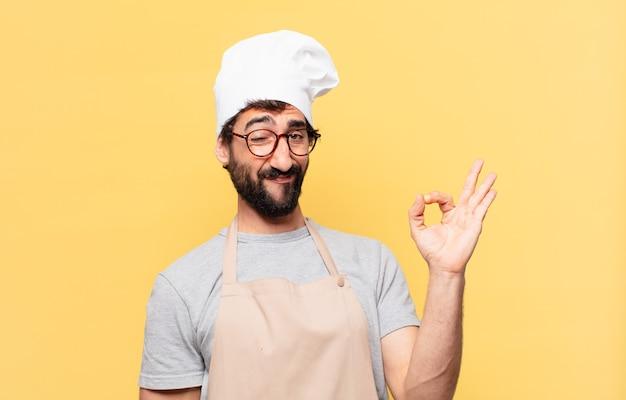 Jonge, bebaarde chef-kok man gelukkige uitdrukking