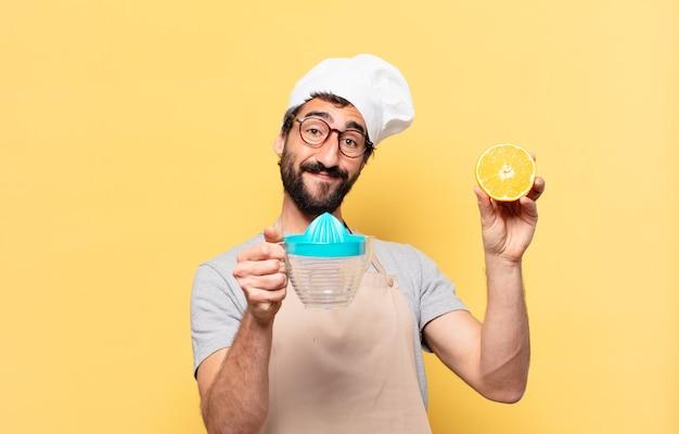 Jonge bebaarde chef-kok man gelukkige uitdrukking