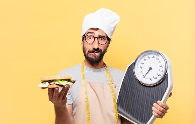Jonge bebaarde chef-kok twijfelende of onzekere uitdrukking