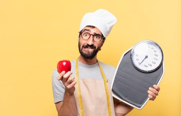 Jonge, bebaarde chef-kok twijfelende of onzekere uitdrukking