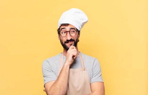 Jonge bebaarde chef-kok twijfelende of onzekere uitdrukking Premium Foto