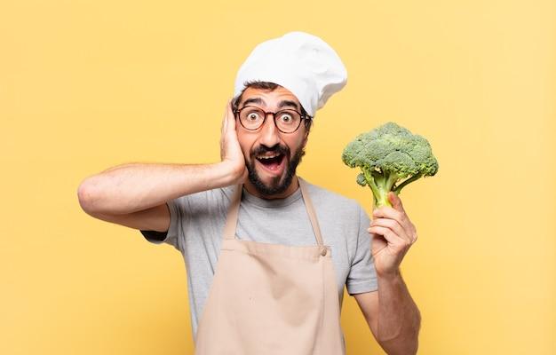 Jonge, bebaarde chef-kok verraste uitdrukking