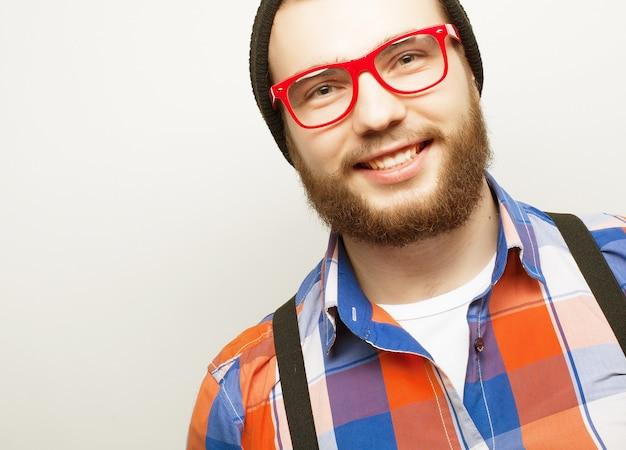 Jonge, bebaarde hipster man met bril eye