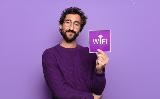 Jonge, bebaarde man gratis wifi-concept