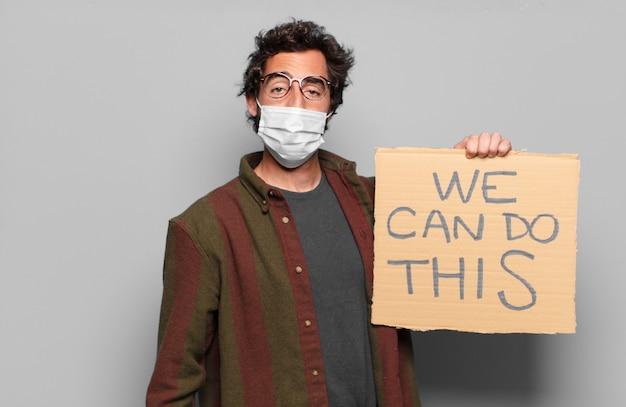 Jonge, bebaarde man met een medisch masker en we kunnen dit concept doen