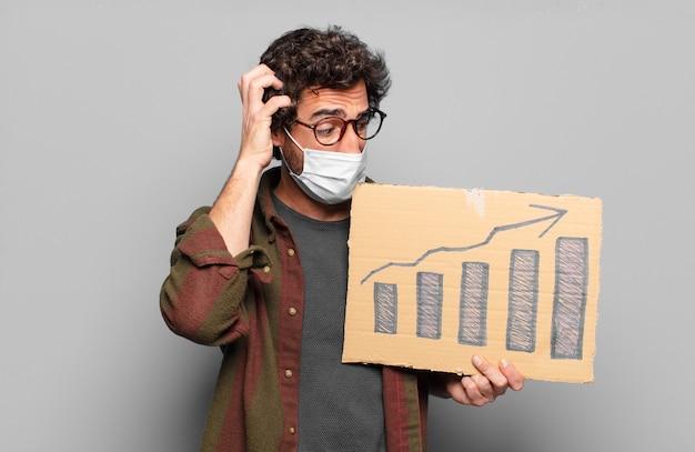 Jonge, bebaarde man met een medisch masker. groei concept