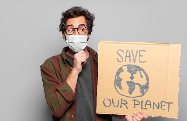 Jonge, bebaarde man met een medisch masker. red ons planeetconcept