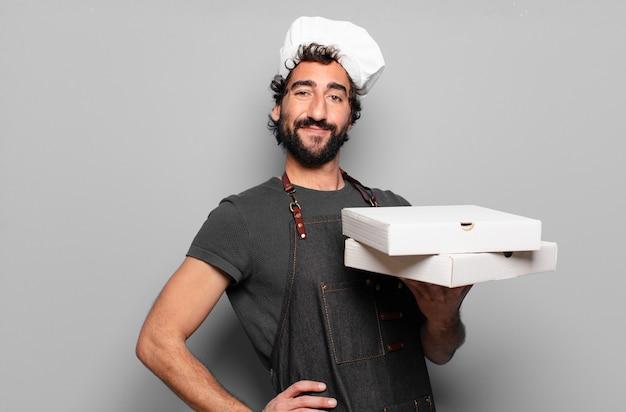 Jonge, bebaarde man. pizza chef-kok concept