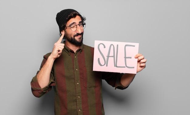Jonge, bebaarde man verkoop concept