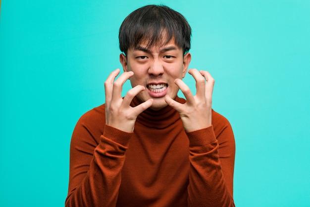Jonge chinese boos en verstoorde mens