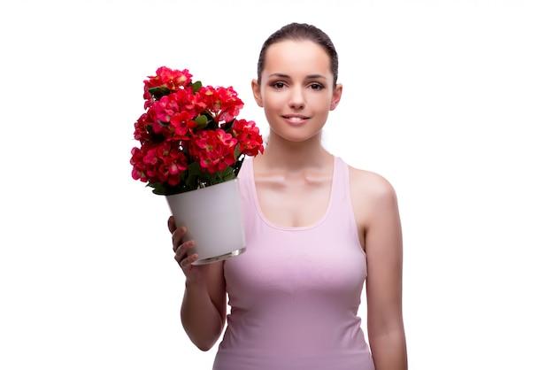 Jonge die vrouw met bloempot op wit wordt geïsoleerd