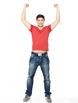 Jonge gelukkig man met in casuals met opgeheven handen omhoog geïsoleerd op wit