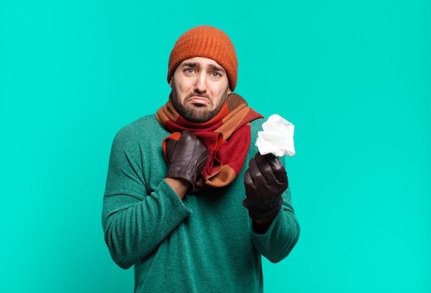 Jonge knappe man griep. ziekte concept