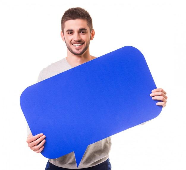 Jonge knappe man met een blauwe tekstballon