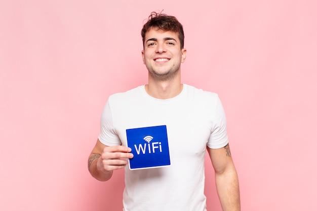 Jonge knappe man met wi-fi-teken