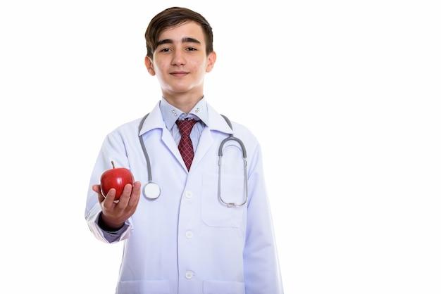 Jonge knappe perzische tiener arts die rood geeft