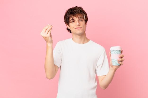 Jonge man met een koffie-capice of geldgebaar, die je zegt te betalen
