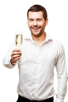 Jonge man met glas champagne