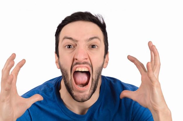 Jonge man schreeuwen en schreeuwen