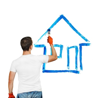 Jonge man tekenen huis ico