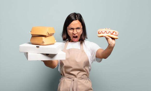 Jonge mooie chef-kokvrouw. fastfood concept