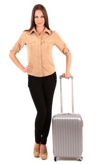 Jonge onderneemster met koffer die op wit wordt geïsoleerd
