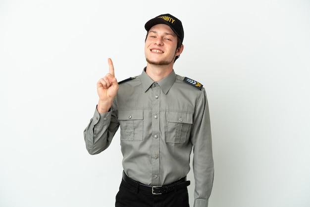 Jonge russische veiligheidsman geïsoleerd op een witte achtergrond die een vinger toont en optilt in teken van de beste