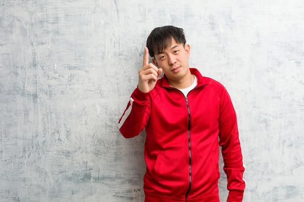 Jonge sportgeschiktheid chinees die nummer één toont
