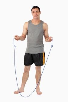 Jonge sportman die voor sprong het roping voorbereidingen treft