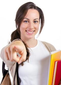 Jonge student met haar boeken op witte achtergrond