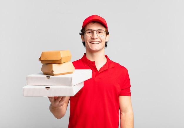Jonge tiener man jonge pizza bezorgt man gelukkige uitdrukking