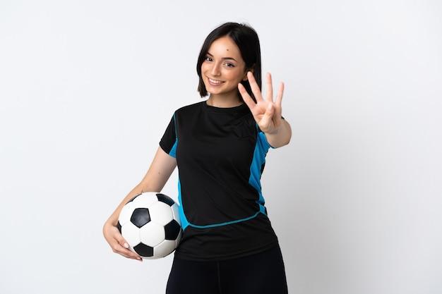 Jonge voetballer vrouw geïsoleerd op wit gelukkig en vier tellen met vingers