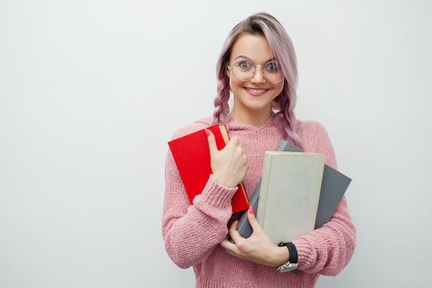 Jonge vrouw met boeken