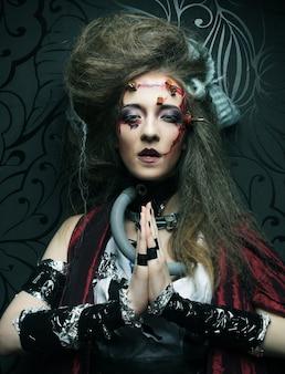Jonge vrouw met creatieve make-up. halloween-thema. zombie-thema.