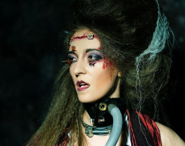 Jonge vrouw met creatieve make-up. sluit omhoog. halloween-thema. zombie-thema.