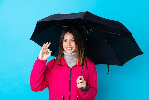 Jonge vrouw met paraplu