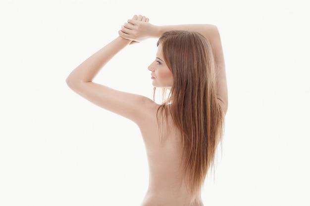Jonge vrouw poseren topless, perfecte huid, achteraanzicht