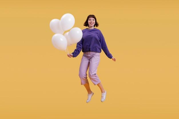 Jonge vrouw springen geïsoleerd op oranje