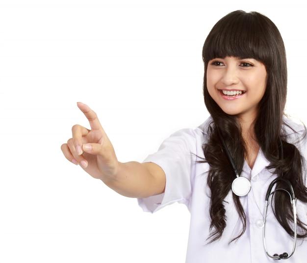 Jonge vrouwelijke chirurg die op copyspace richt