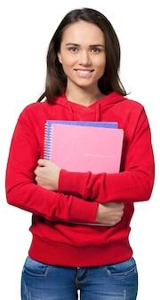 Jonge vrouwelijke studenten met notitieboekjes