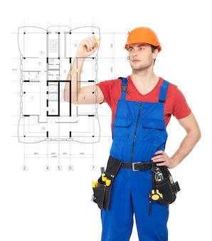 Jonge werknemer tekening de regeling van een nieuw huis