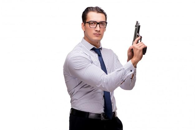 Jonge zakenman met kanon dat op wit wordt geïsoleerd