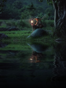 Jongen met lamp op zoek. abstract betekent hoop op leven.