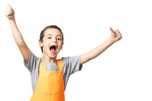 Jongen timmerman in oranje werk overall poseren, bedrijf, thumbs up op witte geïsoleerde achtergrond.