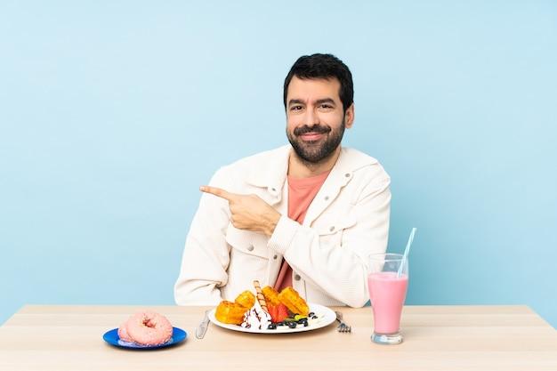 Jongere met voedsel over geïsoleerde achtergrond