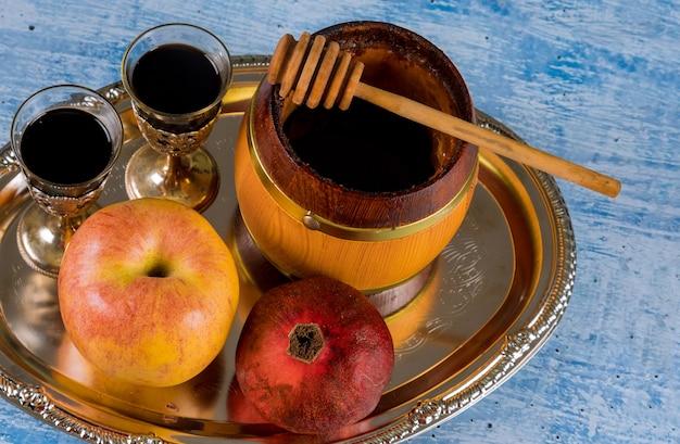 Joodse vakantie rosh hashanah honing en appels met granaatappel