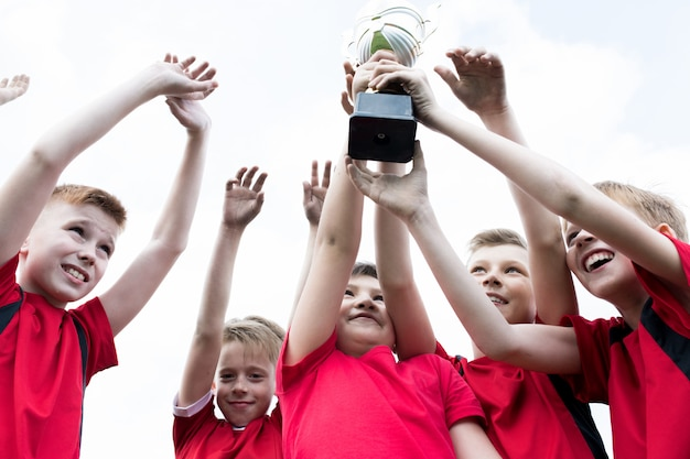 Junior team holding trophy
