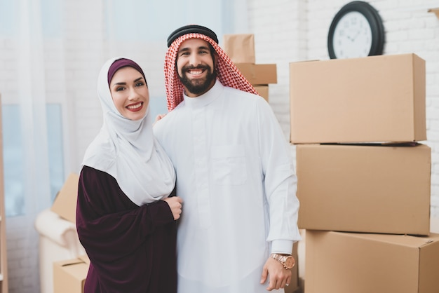 Just married muslims happy owners of apartment.