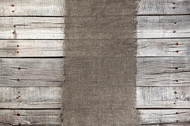 Jute op oude grijze houten,
